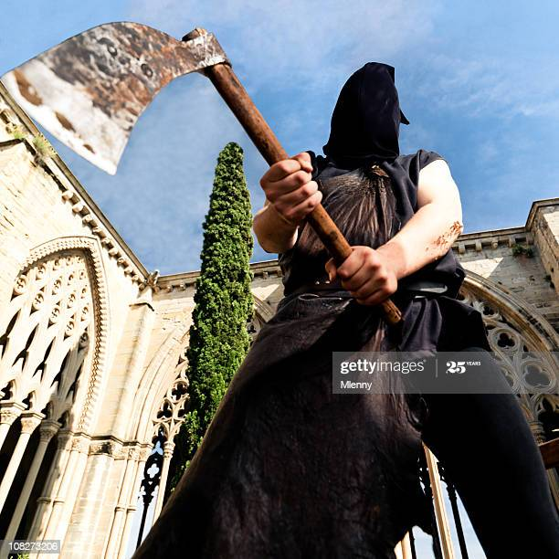public-executioner-with-axe-picture-id108273206.jpg